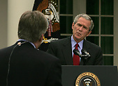 Washington, D.C. - June 14, 2006 -- United States President George W. Bush listens as NBC White House correspondent David Gregory asks a question at a press conference in the Rose Garden of the White House on June 14, 2006<br /> Credit: Dennis Brack - Pool via CNP