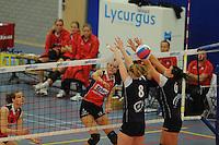 VOLLEYBAL: GRONINGEN: Topsportcentrum Alfacollege, 27-10-2012, Eredivisie Dames, Eindstand 1-3, smash van Monique Volkers (#12) gaat langs het blok van Lycurgus, ©foto Martin de Jong