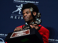 New York, NY - December 10, 2016: Louisville quarterback Lamar Jackson poses with his Heisman trophy during a news conference at the New York Marriott Marquis, December 10, 2016. At the time Jackson won the Heisman, he has a total of 4,928 offensive yards, 2nd of all-time for a Heisman winner. (Photo by Don Baxter/Media Images International)