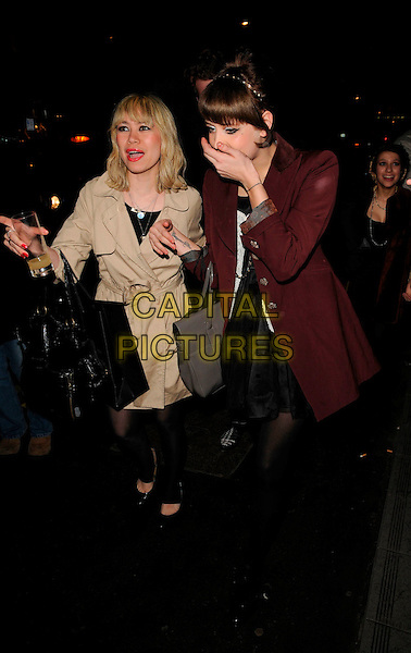 PEACHES GELDOF.Nokia & PPQ Launch Party at PPQ Boutique, Conduit Street, London, England, January 29th 2008..full length red maroon coat hand over face mouth funny black shoes tights fringe bag.CAP/CAN.©Can Nguyen/Capital Pictures