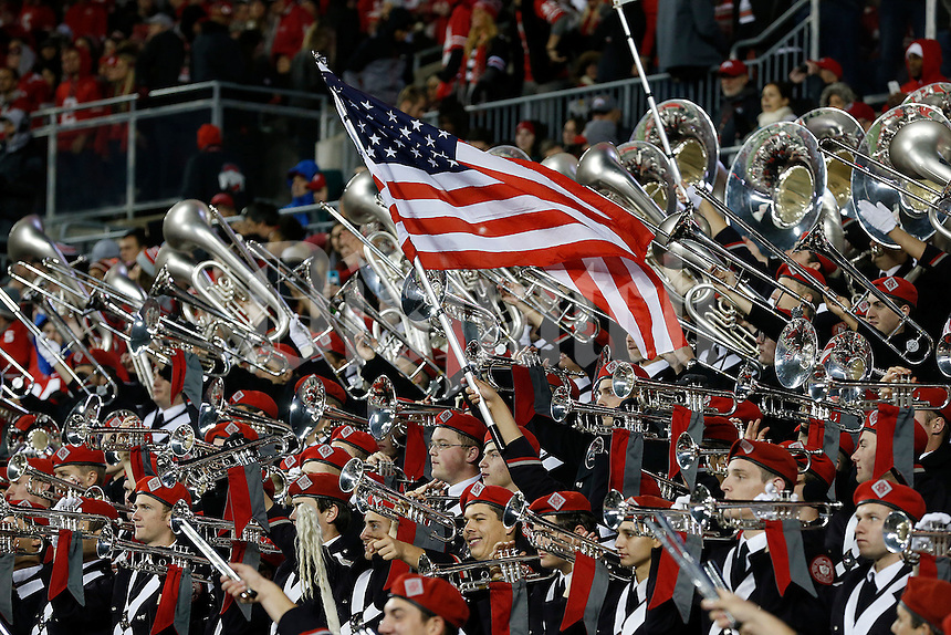 The Ohio State University Marching Band raises the flag in the second half of their game at Ohio Stadium in Columbus, Ohio on November 7, 2015. (Columbus Dispatch photo by Brooke LaValley)