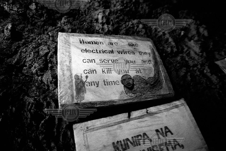 "A slogan inside a house in Kibera: ""Women are like electrical wires - they can serve you and can kill you at any time."""