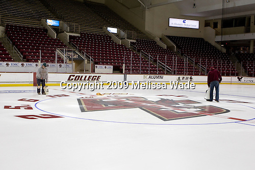 Paul Gallivan and Joe Russo lay down some final layers of fine mist before large amounts of water get added to fill in center ice. Paul Gallivan and his crew paint the numbers of any senior players and the initials of any senior managers of the men's and women's Boston College hockey teams at center ice prior to the final home game of the regular season.  On the evening of Tuesday, March 3, 2009, they painted the numbers and initials for the men's team after cutting out the women's numbers earlier that day (the women's regular season ends two weeks earlier than the men's.)