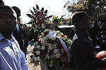 Men carry flowers and young boys basketballs from St. Sabina's after the funeral of Tyshawn Lee, 9, who was shot multiple times while playing basketball in an alley on November 2, 2015, in Chicago, Illinois on November 10, 2015. Police allege the killing was a retaliatory gang hit which would mark a new turn in Chicago's gang wars.