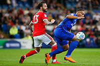 Kenneth Zohore of Cardiff City is marked by Danny Fox of Nottingham Forest during  the Sky Bet Championship match between Cardiff City and Nottingham Forest at the Cardiff City Stadium, Wales, UK. Saturday 21 April 2018