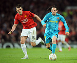 Manchester United's Michael Carrick and Barcelona's Lionel Messi during the Champions League semi-final 2nd leg match at Old Trafford, Manchester. Picture date 29th April 2008. Picture credit should read: Simon Bellis/Sportimage