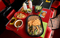 Photos of a carnitas taco dish with rice and beans and sides of guacamole in a molcajete and salsa at Taqueria Pedrito in Dallas, Texas, Thursday, September 3, 2009. Taqueria Pedrito was the first taqueria established in Dallas and opened in the 1970s...