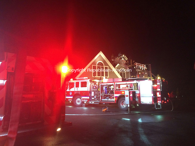 TORRINGTON, CT- 20 May 2015- 052015BJ01-- Torrington firefighters responded to 1971 Weed Road Tuesday night after a lightning strike caused a fire in the attic. Bruno Matarazzo Jr. Republican-American