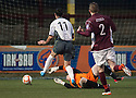 Stranraer's Ryan Borris is caught by Stenny keeper Callum Reidford but referee Matt Northcroft waves play on.