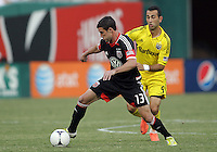 WASHINGTON, DC - AUGUST 4, 2012:  Chris Pontius (13) of DC United shields the ball from Justin Meram (9) of the Columbus Crew during an MLS match at RFK Stadium in Washington DC on August 4. United won 1-0.