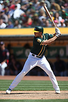 OAKLAND, CA - JUNE 30:  Matt Olson #28 of the Oakland Athletics bats against the Cleveland Indians during the game at the Oakland Coliseum on Saturday, June 30, 2018 in Oakland, California. (Photo by Brad Mangin)
