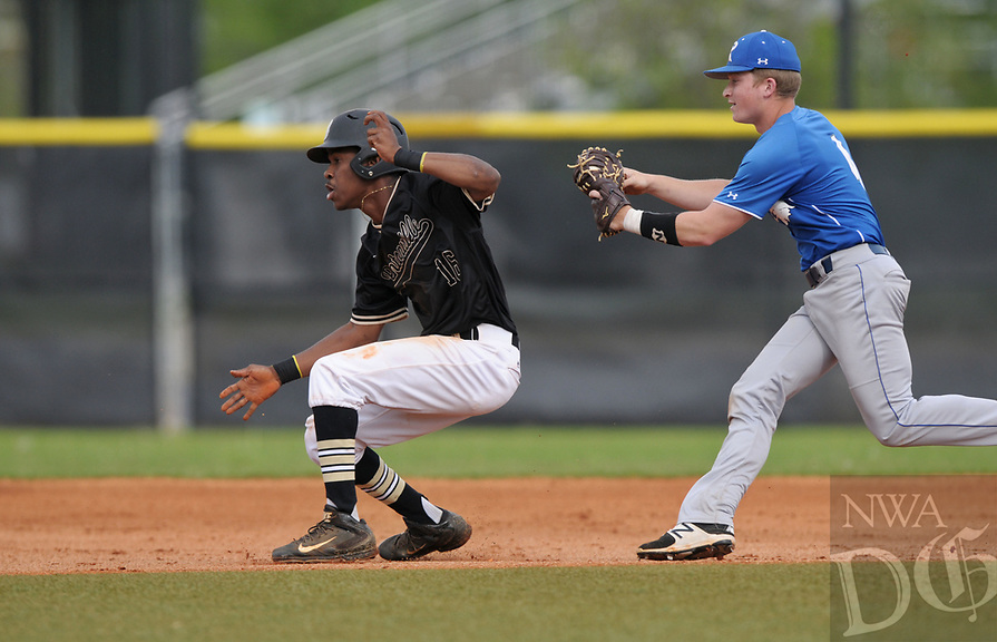 NWA Democrat-Gazette/BEN GOFF @NWABENGOFF<br /> Mason Mitchell, Rogers first baseman, runs down Bentonville runner Kam'ron Mays-Hunt after he was caught on a pickoff throw to first Monday, April 17, 2017, during the first inning at the Tiger Athletic Complex in Bentonville.