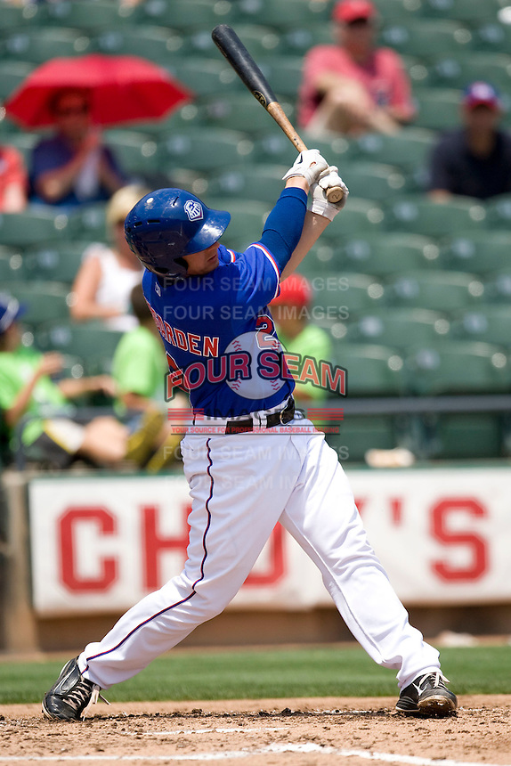Catcher Taylor Teagarden #2 of the Round Rock Express swings against the Nashville Sounds in Pacific Coast League baseball on May 9, 2011 at the Dell Diamond in Round Rock, Texas. (Photo by Andrew Woolley / Four Seam Images)