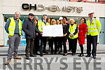 The staff of CH Chemist and Ned O'Shea Construction unveil the plans for the major renoveration of CH Chemist on Tuesday.