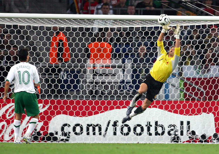 Guillermo Franco (10) of Mexico watches Angola goalkeeper Joao Ricardo (1) make a save. Mexico and Angola played to a 0-0 tie in their FIFA World Cup Group D match at FIFA World Cup Stadium, Hanover, Germany, June 16, 2006.