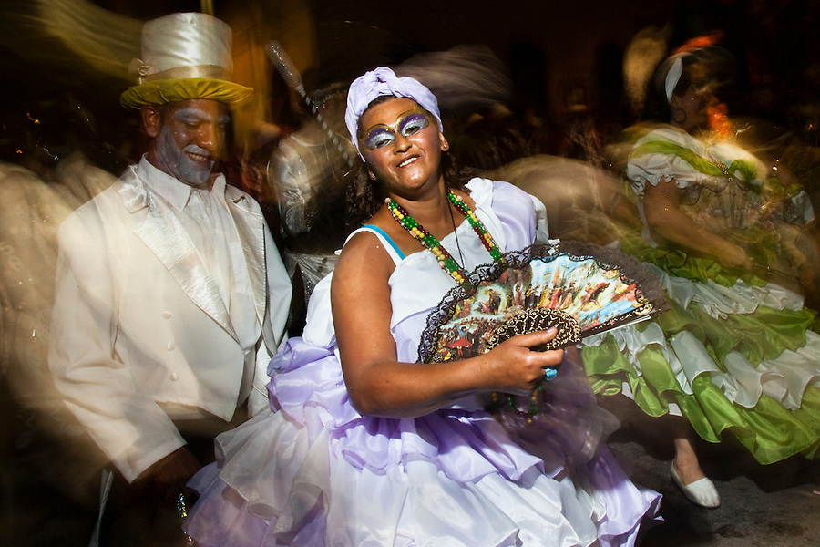 A Mama Vieja (old mother) and Gramillero dance in the parade of Llamadas in Montevideo.  One of the most imporant elements of Carnaval in Uruguay is Candombe, an African drum rhythm played on tambor drums.  It was revitalized in the Americas by black slave descendents as a way by which to reclaim their cultural heritage and battle for civil rights.