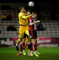 Lincoln City's Harry Anderson, right, with team-mate Neal Eardley battles with Milton Keynes Dons' Carlton Morris<br /> <br /> Photographer Chris Vaughan/CameraSport<br /> <br /> The EFL Sky Bet League One - Lincoln City v Milton Keynes Dons - Tuesday 11th February 2020 - LNER Stadium - Lincoln<br /> <br /> World Copyright © 2020 CameraSport. All rights reserved. 43 Linden Ave. Countesthorpe. Leicester. England. LE8 5PG - Tel: +44 (0) 116 277 4147 - admin@camerasport.com - www.camerasport.com