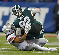 Ohio State Buckeyes cornerback Bradley Roby (1) pulls down Michigan State Spartans tight end Josiah Price (82) for a tackle in the 3rd quarter during the Big 10 Championship game at Lucas Oil Stadium in Indianapolis, Ind on December 7, 2013.  (Dispatch photo by Kyle Robertson)