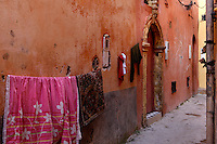 "Clothes hanging on string in front of old houses in a narrow street, Portuguese Fortified city of Mazagan, El Jadida, Morocco. El Jadida, previously known as Mazagan (Portuguese: Mazag""o), was seized in 1502 by the Portuguese, and they controlled this city until 1769. Picture by Manuel Cohen"
