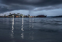 Stilt houses in the Bajau village of Pulo Papan in the Togean Islands, as a thunder storm rolls in.