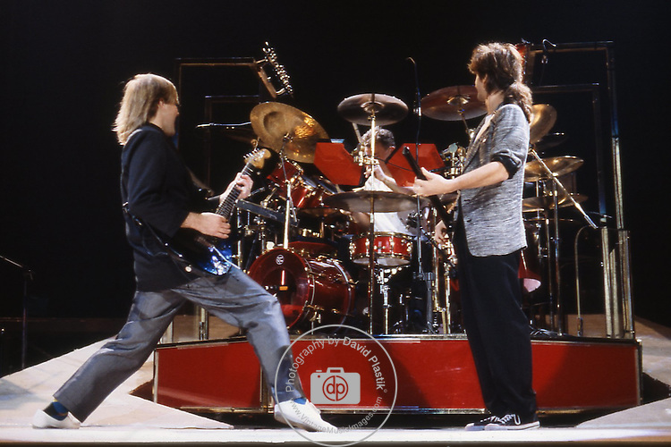Alex Lifeson, Geddy Lee & Neil Peart performing live in the USA in 1985.