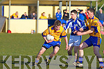 Ballymac's Matthew Galvin and Con Reynolds hold off Templenoe's Denis O'Neill in the division 3 clash at Ballymac on Saturday.