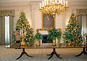 "The 2017 White House Christmas decorations, with the theme ""Time-Honored Traditions,"" which were personally selected by first lady Melania Trump, are previewed for the press in Washington, DC on Monday, November 27, 2017.   This is a view of the State Dining Room looking from the door of the Red Room.<br /> Credit: Ron Sachs / CNP"