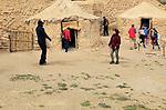 Tourists exploring  Los Millares prehistoric settlement, Almeria, Spain