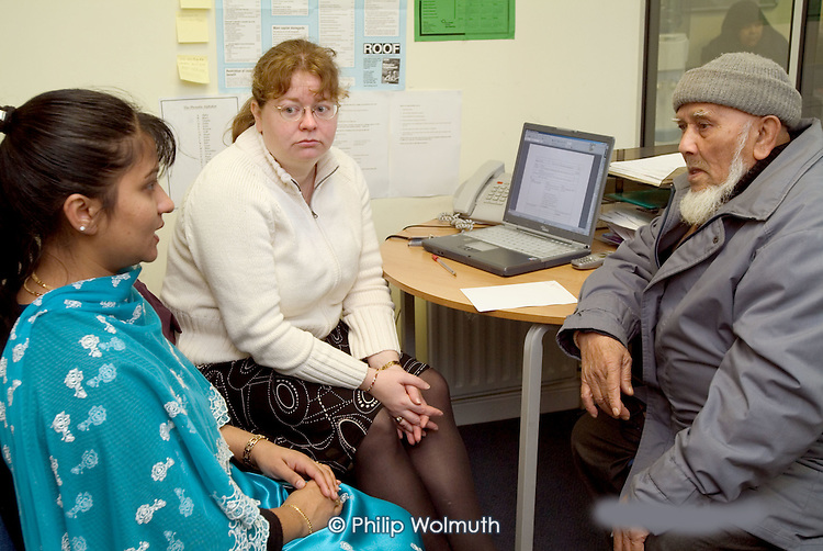 Housing and welfare rights advice session with an interpreter at the Marylebone Bangladeshi Society, Paddington, London.