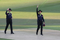 Umpires Rob Bailey and Mike Burns (R) summon the players back on to the field after a delay due to the setting sun during Kent Spitfires vs Essex Eagles, Vitality Blast T20 Cricket at the St Lawrence Ground on 2nd August 2018