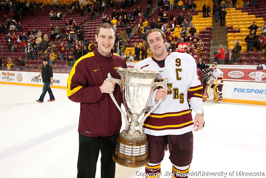 3 Mar 12: The University of Minnesota Golden Gophers Men's Hockey Team celebrates winning the MacNaughton Cup, given to the WCHA regular season champion...NCAA Bylaw 12.5.11 prohibits the use of a student-athlete's name, picture, or identity to promote the sale of a commercial product or service. It is the intent of the University of Minnesota that this photo shall no be used in any way that may constitute advertising or promotion of any commercial product or service.