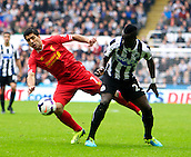 19.10.2013  Newcastle, England. Liverpool's Luis Suarez with Newcastle's Cheick Tiote  during the Barclays English Premier League  match between Newcastle United  and Liverpool,  From St James's Park, Newcastle.