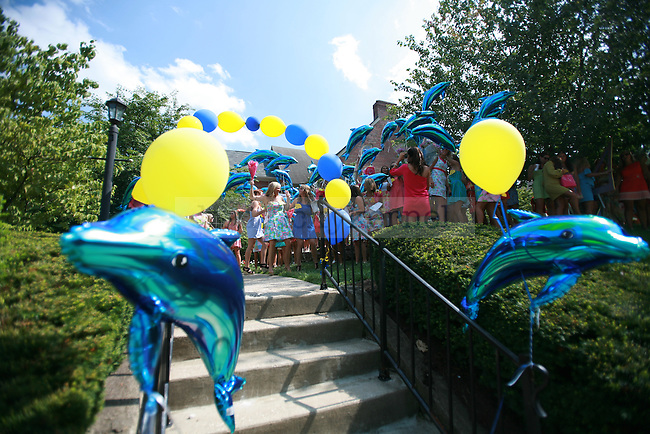 Delta Delta Delta sorority members decorated their walkway to their sorority house with dolphins, their sorority mascot. The Tri-Delt sorority cheers during the 2011 sorority bid day event on Thursday, August 18, 2011. Photo by Brandon Goodwin | Staff