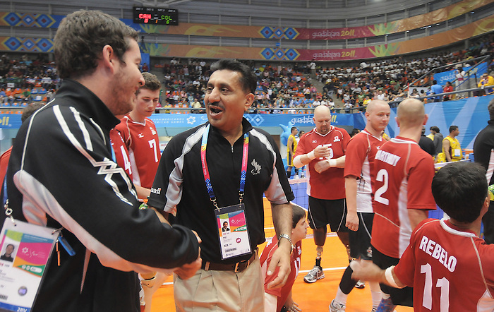 November 18 2011 - Guadalajara, Mexico:  Canada's Minister of Sport Bal Gosal congratulates Team Canada after they defeated Team Columbia in the Bronze Medal Game in the Pan American Volleyball Complex at the 2011 Parapan American Games in Guadalajara, Mexico.  Photos: Matthew Murnaghan/Canadian Paralympic Committee