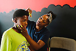 Leondra Wiley inspects her son Quentin Wiley's hair after a haircut from Kent the Barber at Graffitis SWAG Shop in South Atlanta, Georgia, July 25, 2013.