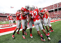 Teammates congratulate Ohio State Buckeyes cornerback Eli Apple (13) for scoring a touchdown on a fumble recovery during the second quarter of the NCAA football game against the Rutgers Scarlet Knights at Ohio Stadium in Columbus on Oct. 18, 2014. (Adam Cairns / The Columbus Dispatch)
