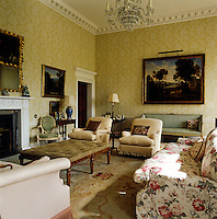 This formal living room is furnished with an Aubusson carpet and a formal arrangement of sofas and armchairs