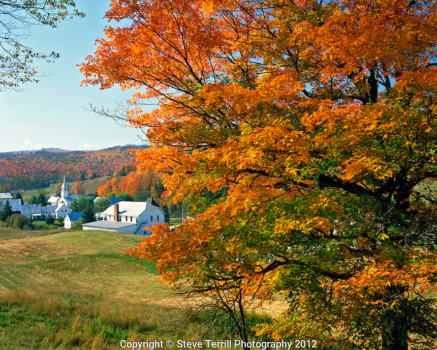 Fall colors framing church and town of East Corinth Vermont