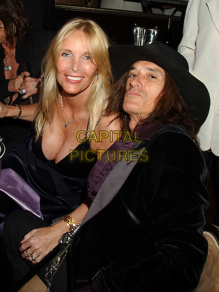 JOE PERRY - AEROSMITH & GUEST.2006 Clive Davis Pre-GRAMMY Party sponsored by L'Oreal, Rhapsody, and XM Satellite Radio held at the Beverly Hilton Hotel, Beverly Hills, California, USA..February 6th, 2006.Photo: Laura Farr/AdMedia/Capital Pictures.Ref: LF/ADM.half length cleavage black hat.www.capitalpictures.com.sales@capitalpictures.com.© Capital Pictures..