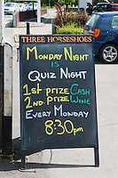 Signs outside the Three Horseshoes public house, Cranleigh, Surrey.