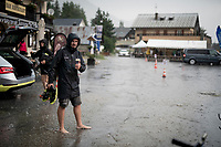 Just as the race finishes, a serious thunderstorm (including hail, hits the area and the Mitchelton-Scott crew enjoy themselves during of this cooling moment<br /> <br /> Stage 18: Embrun to Valloire(208km)<br /> 106th Tour de France 2019 (2.UWT)<br /> <br /> ©kramon