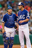 Oklahoma City Dodgers catcher Brian Ward (10) meets with pitcher Ian Thomas (43) during the Pacific Coast League baseball game against the Nashville Sounds on June 12, 2015 at Chickasaw Bricktown Ballpark in Oklahoma City, Oklahoma. The Dodgers defeated the Sounds 11-7. (Andrew Woolley/Four Seam Images)