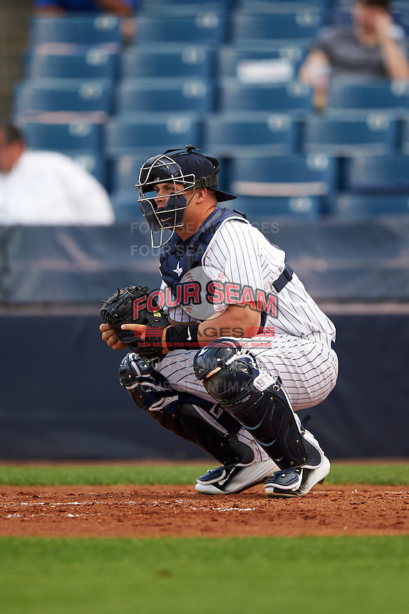 Tampa Yankees catcher Wes Wilson (6) warms up the pitcher in between innings during a game against the Bradenton Marauders on April 11, 2016 at George M. Steinbrenner Field in Tampa, Florida.  Tampa defeated Bradenton 5-2.  (Mike Janes/Four Seam Images)