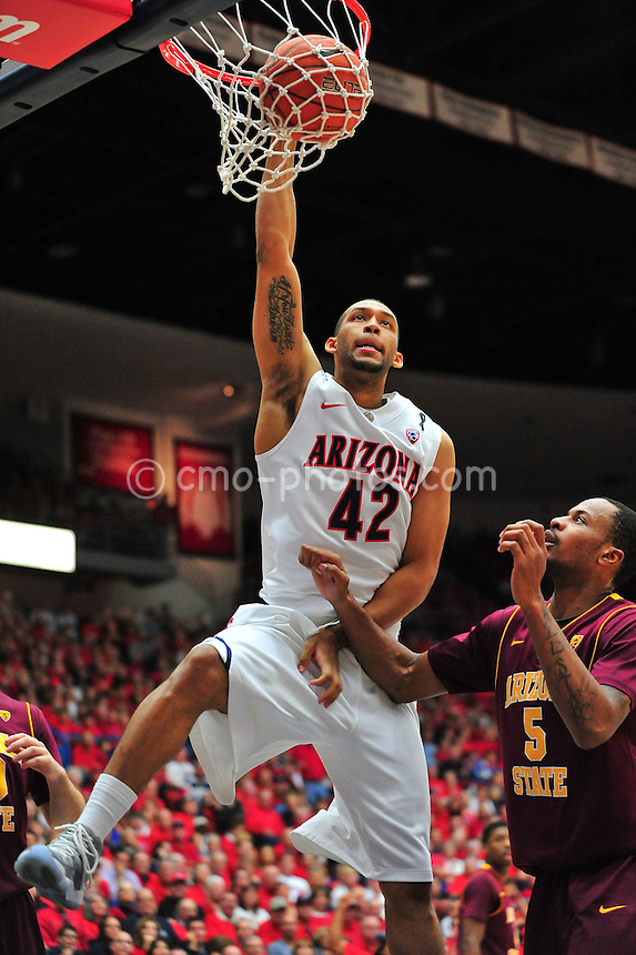 Jan 15, 2011; Tucson, AZ, USA; Arizona Wildcats forward Jamelle Horne (42) dunks the ball as Arizona State Sun Devils forward Kyle Cain (5) looks on in the 2nd half of a game at the McKale Center.  The Wildcats won the game 80-69.
