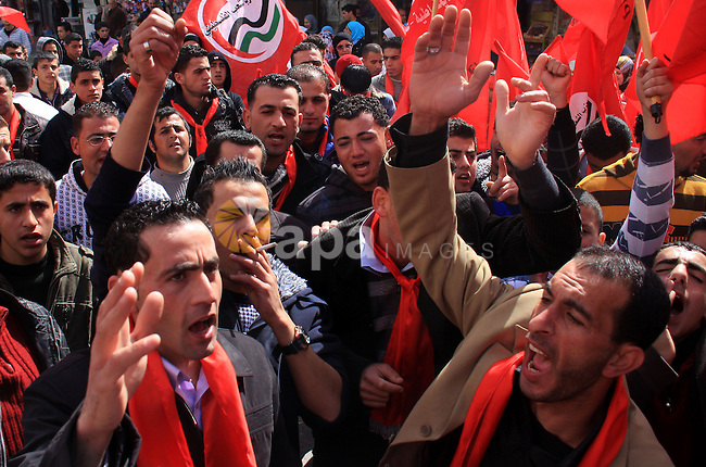 Palestinian supporters of the Palestinian Peoples Party (PPP) shout slogans during a rally in the centre of the West Bank city of Nablus demanding an end to the split between the Gaza Strip and the West Bank and calling for political reconciliation between the Fatah party and the Islamist movement Hamas, 26 February 2011. Photo by Wagdi Eshtayah