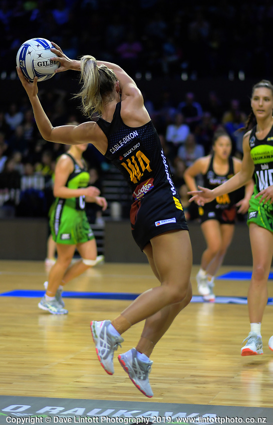 Ariana Cable-Dixon takes a pass during the ANZ Premiership netball match between Central Pulse and WBOP Magic at TSB Bank Arena in Wellington, New Zealand on Sunday, 21 April 2019. Photo: Dave Lintott / lintottphoto.co.nz