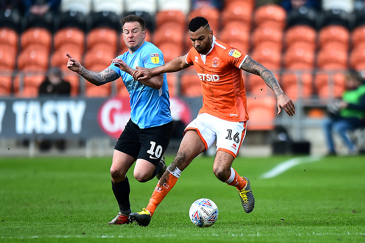 Blackpool's Curtis Tilt vies for possession with Southend United's Simon Cox<br /> <br /> Photographer Richard Martin-Roberts/CameraSport<br /> <br /> The EFL Sky Bet League One - Blackpool v Southend United - Saturday 9th March 2019 - Bloomfield Road - Blackpool<br /> <br /> World Copyright © 2019 CameraSport. All rights reserved. 43 Linden Ave. Countesthorpe. Leicester. England. LE8 5PG - Tel: +44 (0) 116 277 4147 - admin@camerasport.com - www.camerasport.com