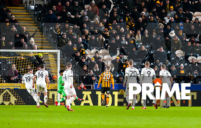 Hull City's forward Nouha Dicko (9) slots it past Sheffield United's goalkeeper Jamal Blackman (27) to give his side the lead during the Sky Bet Championship match between Hull City and Sheff United at the KC Stadium, Kingston upon Hull, England on 23 February 2018. Photo by Stephen Buckley / PRiME Media Images.