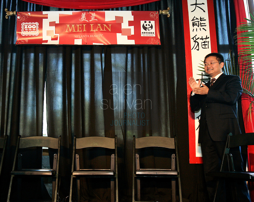 Dr. Zhang Zhihe, director of the Chengdu Research Base of Giant Panda Breeding, applauds at the unveiling of the name of the Zoo Atlanta's giant panda cub. ?Mei Lan,? which translates to ?Atlanta Beauty? won in an online poll, receiving 22% of the 57,015 votes cast. Voters were given a list of 10 names from which to choose. The names were suggested by several institutions interested in panda conservation including local media, Zoo Atlanta staff and volunteers, Panda Express (a Zoo Atlanta sponsor) and the people of China.<br />