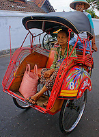 old lady going shopping in a traditional bemo (three wheel taxi), Yogyakarta, island Java, archipelago of Indonesia,  September 2011